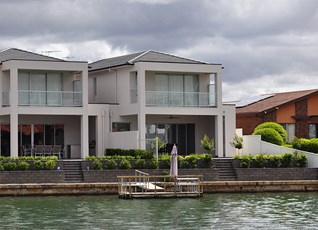 A typical South Pacific water front home that gels well with its beige surroundings