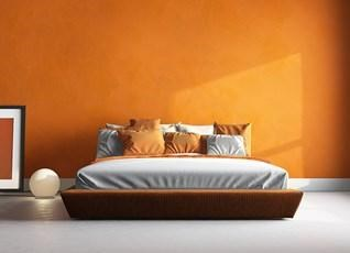 Paint one wall with a vibrant shade to uplift the room's energy